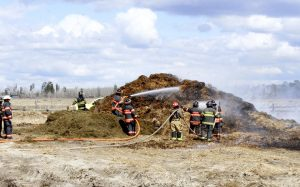 firefighters at a farm